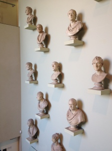 image of lots of busts on a wall
